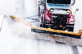 stock photo of cold-weather  - Snowplow Truck Removing the Snow from the Highway during a Cold Snowstorm Winter Day - JPG