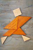 foto of tangram  - abstract of a dancing - JPG