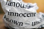 pic of innocence  - Close up of Innocent text on paper - JPG