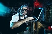 stock photo of scientist  - Old scientist working in his laboratory - JPG