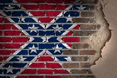 image of flag confederate  - Dark brick wall texture with plaster  - JPG