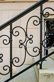 image of scrollwork  - Wrought Iron Scrollwork on a Railing in Savannah Georgia - JPG