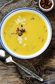 image of chanterelle mushroom  - pumpkin soup with chanterelles on a dark wood background - JPG