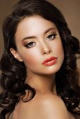 stock photo of auburn  - Gorgeous Alluring Lady with Tress and Bronzed Skin - JPG