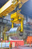 foto of coil  - crane loading of metal on a roll in the plant steel coils - JPG