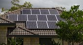 foto of roofs  - Solar photovoltaic panels installed on tiled roof - JPG