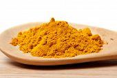 stock photo of rhizomes  - Fresh  turmeric powder on wood background - JPG