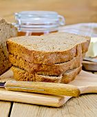 ������, ������: Rye homemade bread with honey and knife on board