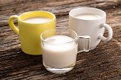 picture of milk glass  - Studio Shot of Fresh glass of milk on old wood background - JPG