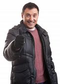 foto of down jacket  - Handsome man in a down jacket showing his thumbs up - JPG