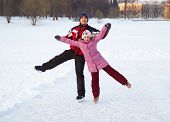 picture of skate  - Happy family on skating rink outdoors - JPG