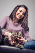 pic of cuddle  - Young smiling woman cuddling her long hair beautiful cat - JPG