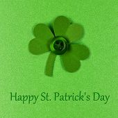 image of shamrock  - Happy St Patrick Day text with handmade shamrock on a green paper background - JPG