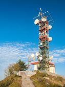 stock photo of relay  - A broadcast relay station for television and radio broadcasting on the summit of mount Fasce near Genoa  - JPG