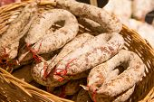 stock photo of charcuterie  - The few traditional French Savoyarde sausages in the market - JPG