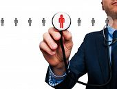 pic of recruiting  - Businessman hand with stethoscope - JPG