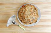 picture of frizzle  - Frying homemade pancakes with sour cream on wooden table - JPG