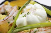 stock photo of saffron  - Poached egg with saffron risotto and vegetables - JPG