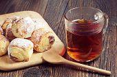 pic of baked raisin cookies  - Cup of hot tea and cookies wit raisins on dark wooden table - JPG