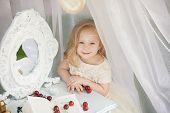 stock photo of faerie  - Outdoor portrait of cute little girl in princess dress - JPG
