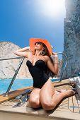 stock photo of shipwreck  - Woman sailing at shipwreck navagio beach in Zakynthos Greece - JPG