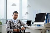 stock photo of programmers  - Portrait of confident Indian programmer at his workplace - JPG