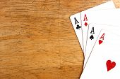 stock photo of ace spades  - Photo of the Four aces of a playing card deck - JPG