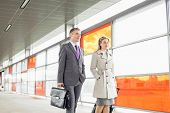 picture of carry-on luggage  - Businesspeople with luggage walking in railroad station - JPG