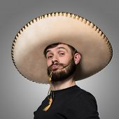 Постер, плакат: portrait of funny man in Mexican sombrero