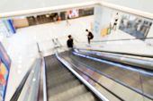 picture of escalator  - Defocused view from escalator to lower floor - JPG