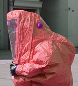 picture of asbestos  - man with yellow protective suit to work in presence of asbestos - JPG