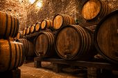 stock photo of wine cellar  - cellar with barrels for storage of wine Italy - JPG