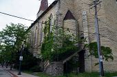 stock photo of carmelite  - The back stairway and door to Saint Mary Carmelite Church in downtown Joliet - JPG