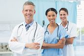 stock photo of medical office  - Confident male and female doctors at medical office - JPG