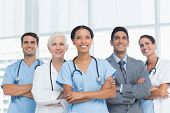 picture of medical office  - Portrait of confident doctors with arms crossed at medical office - JPG