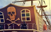 picture of skull crossbones flag  - The photo shows a fragment of the stern of a yacht with the image of a pirate symbols - JPG
