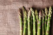 pic of sackcloth  - Fresh asparagus on sackcloth background - JPG