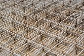 foto of concrete pouring  - Mesh steel rod for construction reinforcement before pouring concrete - JPG