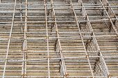 image of concrete pouring  - Mesh steel rod for construction reinforcement before pouring concrete - JPG