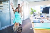 pic of self-employment  - Smiling partners having fun in the office - JPG