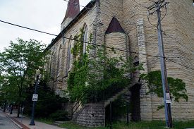 foto of stairway  - The back stairway and door to Saint Mary Carmelite Church in downtown Joliet - JPG