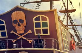 foto of skull crossbones flag  - The photo shows a fragment of the stern of a yacht with the image of a pirate symbols - JPG