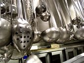 pic of kitchen utensils  - these spoons and ladles are tools of the trade for a chef in a commercial kitchen - JPG