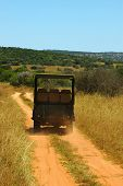 stock photo of loamy  - a typical african vehicle on safari driving on a loamy soil road showing tourists the beauty of an african safari  - JPG