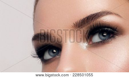 poster of Macro Shot Of Woman's Beautiful Eye With Extremely Long Eyelashes. Sexy View, Sensual Look. Female E