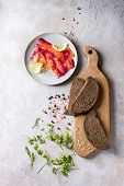 Sliced Beetroot Marinated Salmon For Sandwiches With Sliced Rye Bread, Pink Salt, Pepper, Greens And poster