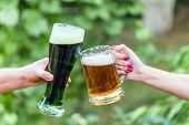 Mug Of Green Irish Beer In Hand. Patricks Day poster