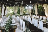 Decorated Elegant Wooden Wedding Table For Banquet Outdoor In Garden, In The Style Of Rustic With Eu poster