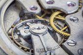 Macro Shot Of Clockwork Gears Inside The Old Watch poster