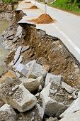 foto of landslide  - Destroyed road landslide damaged in powerful flood - JPG